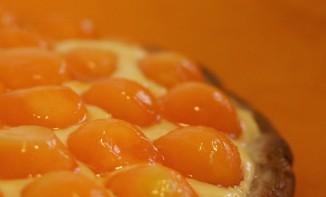Tarte au melon en billes, pâte sablée à l'huile d'olive et crème pâtissière aux zestes de citron